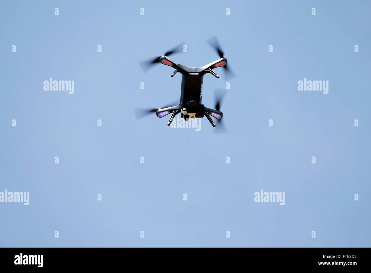 A drone quadcopter in flight. - Stock Image