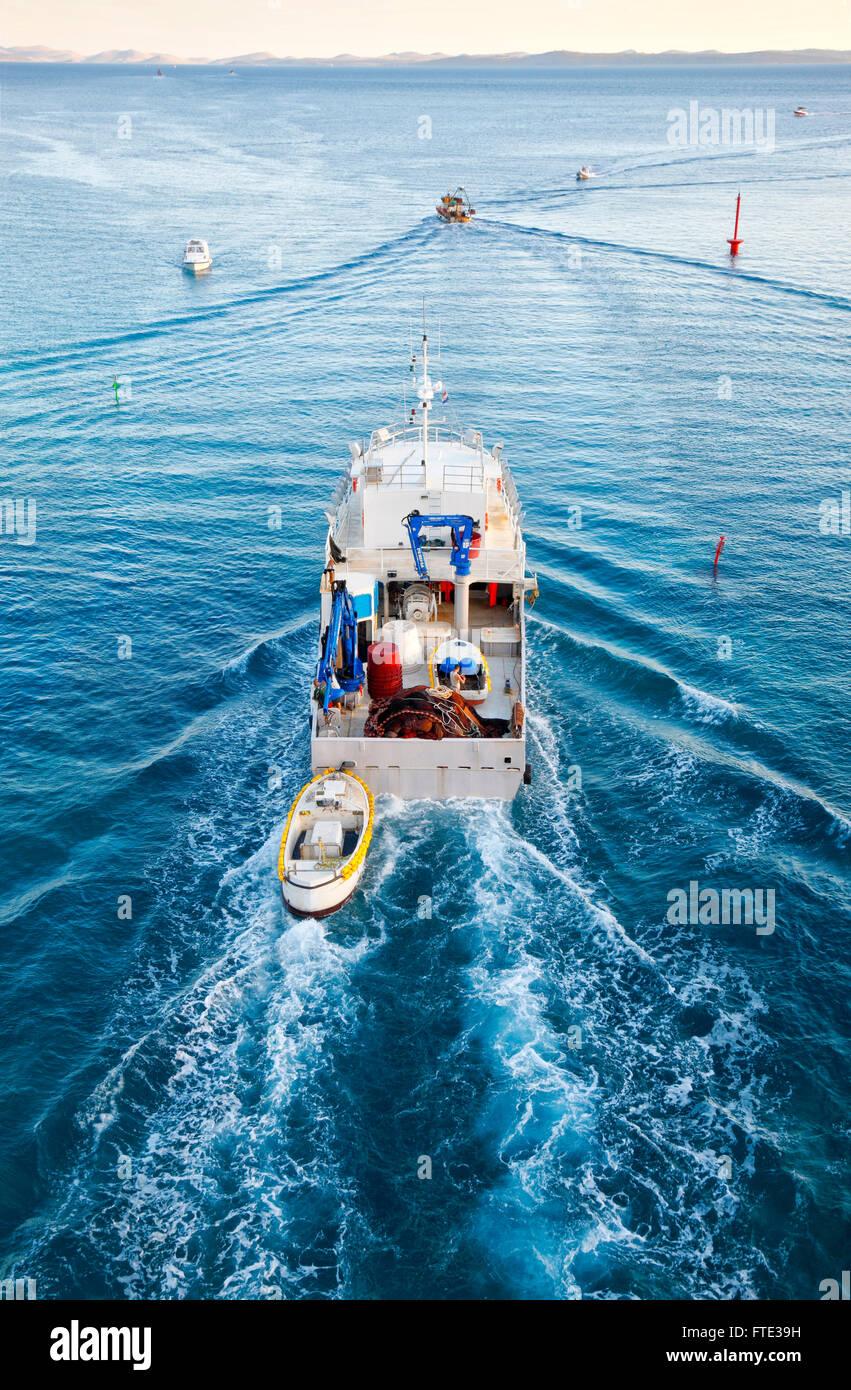 Fishing boat sail to open sea, Croatia - Stock Image