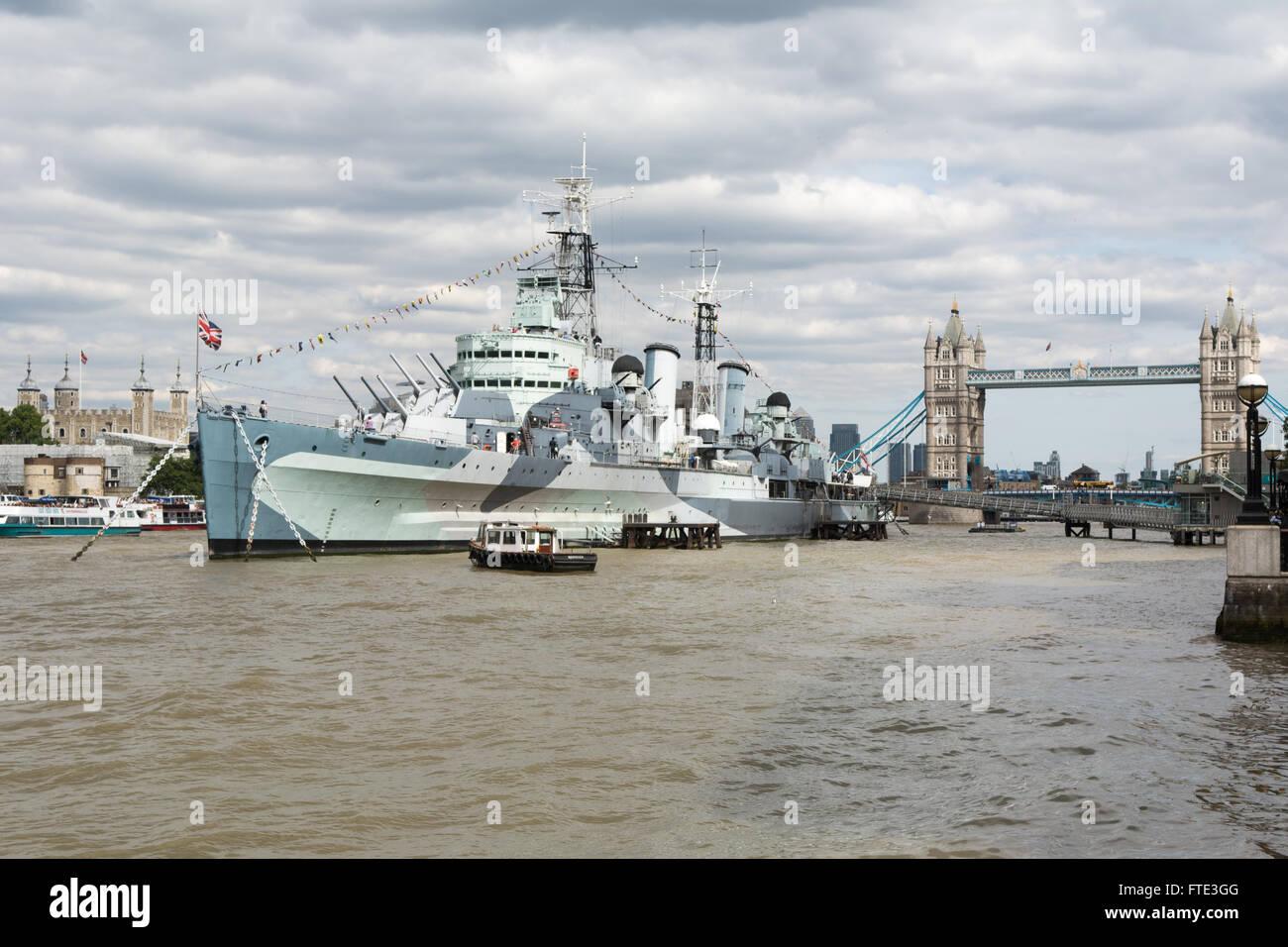 HMS Belfast moored on Thames - Stock Image