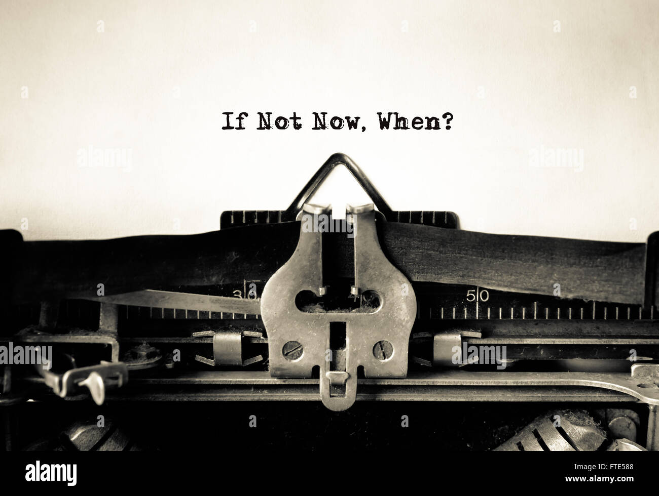 If Not Now, When Inspirational message typed on vintage typewriter Stock Photo