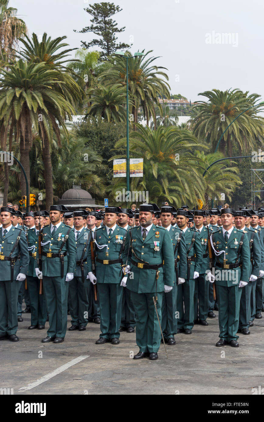 Alameda Park, Malaga, Costa del Sol, Spain.  Members of the Spanish Guardia Civil honouring their patron saint. - Stock Image