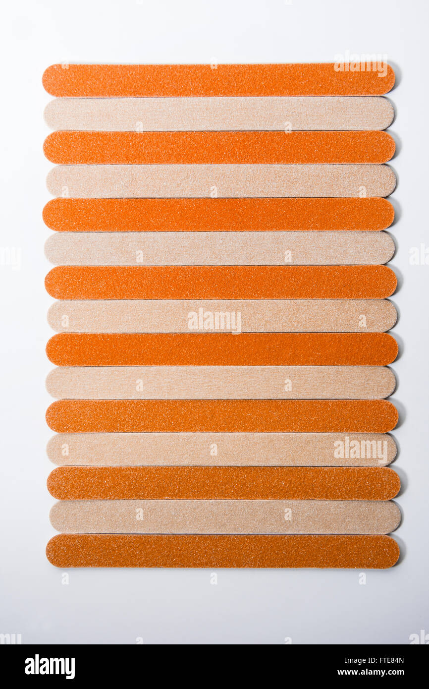Cardboard nail files or emery boards in a row. - Stock Image