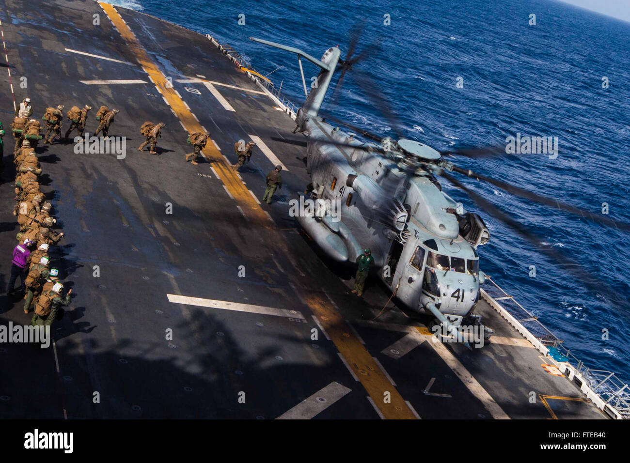 140307-M-HZ646-267: USS BATAAN, at sea (March 7, 2014) - U.S. Marines and Sailors with Battalion Landing Team 1st - Stock Image