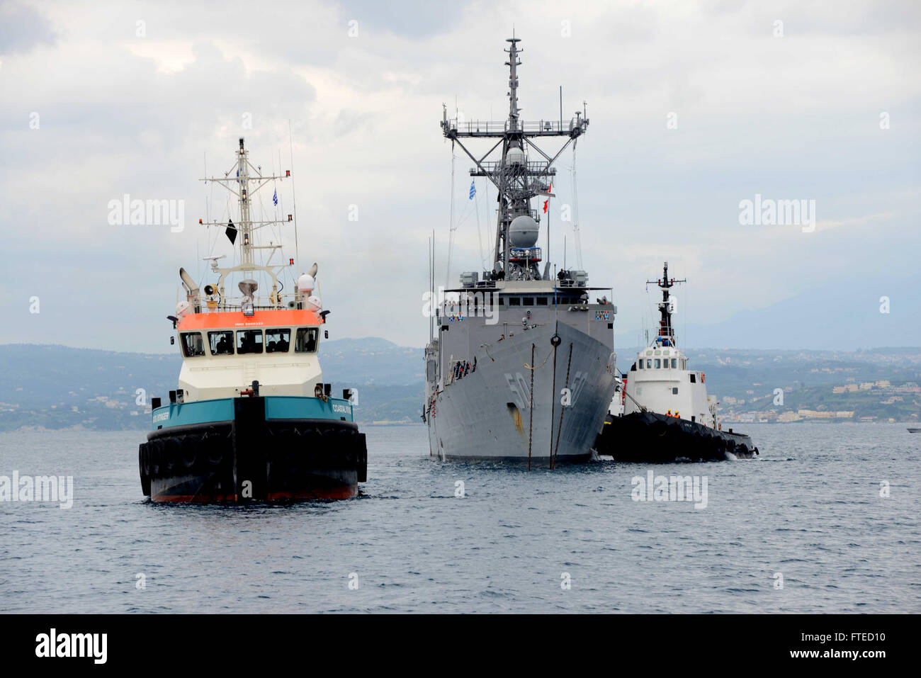 SOUDA BAY, Greece (March 12, 2014) - The guided missile frigate USS Taylor (FFG 50) arrives at Marathi NATO pier - Stock Image