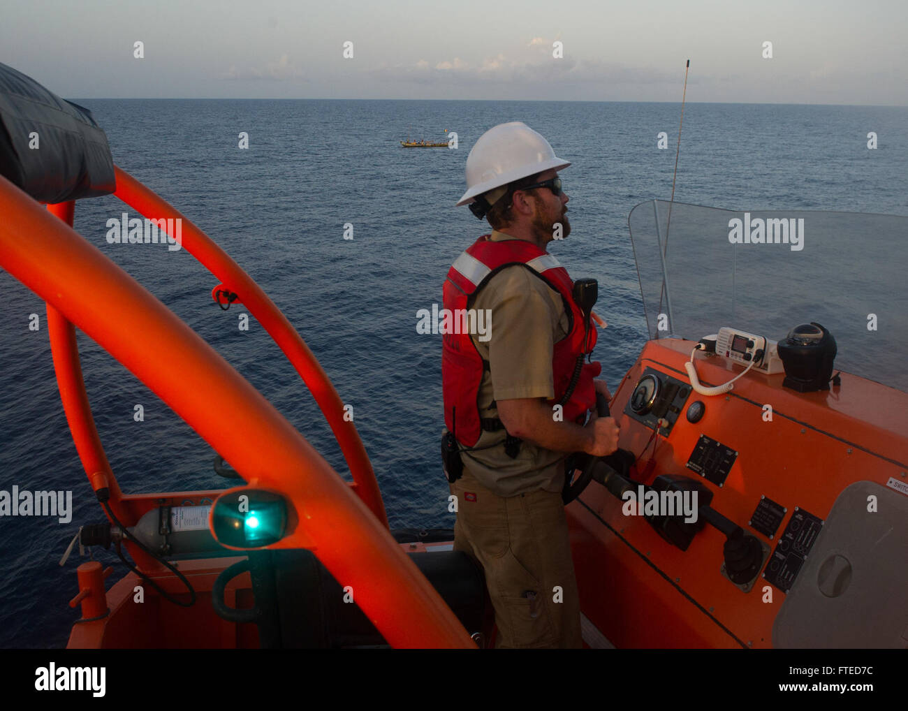 140408-N-ZY039-038  GULF OF GUINEA (April 8, 2014) - James Regan, chief mate aboard joint, high-speed vessel USNS - Stock Image