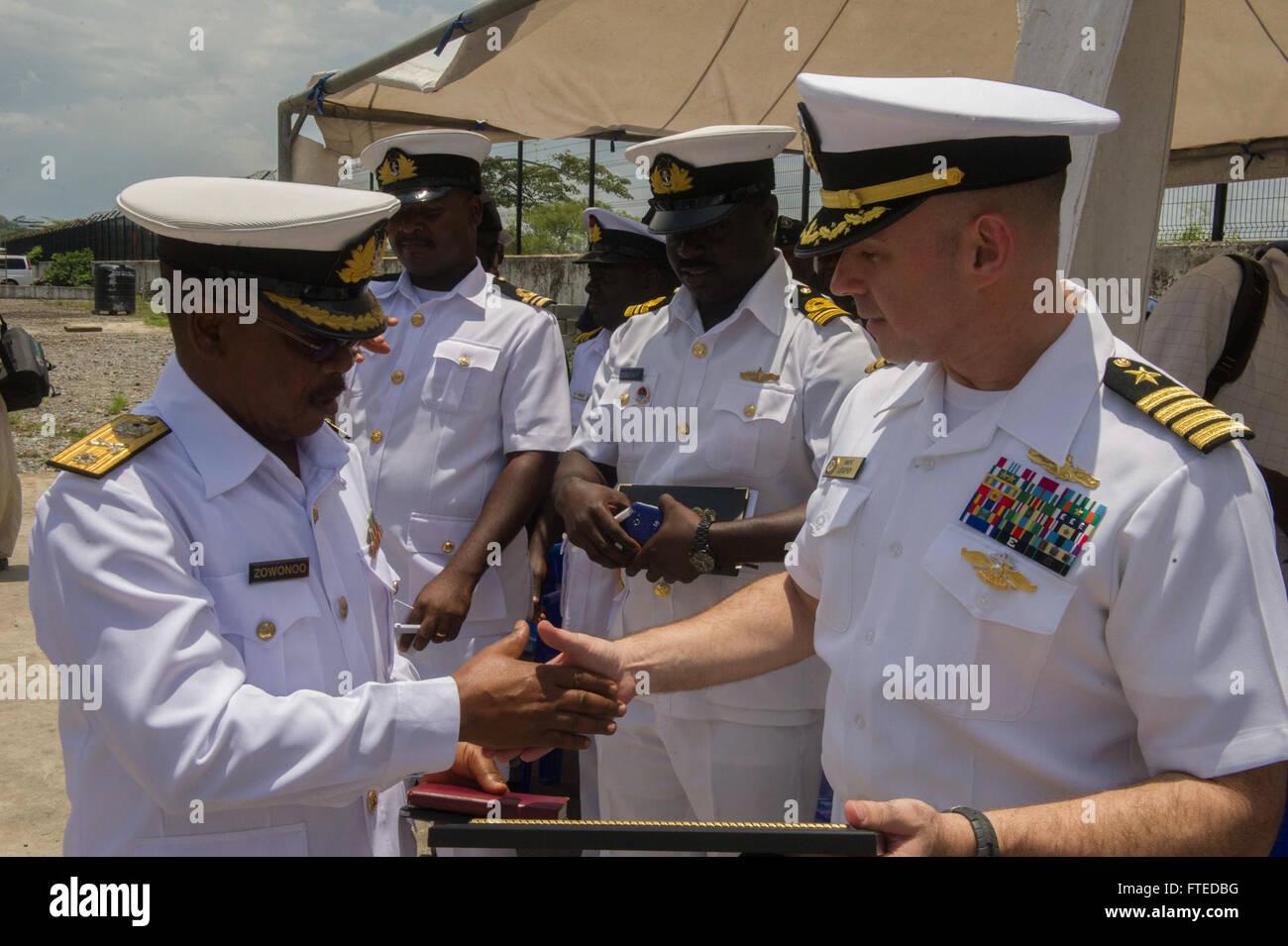 140411-N-ZY039-132 SEKONDI, Ghana (April 11, 2014) - U.S. Navy Capt. Marc Lederer, mission commander aboard joint, - Stock Image
