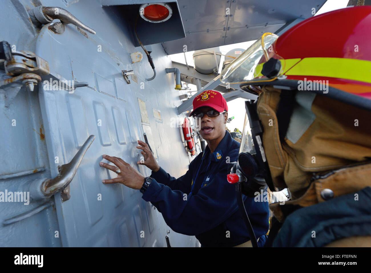 140812-N-IY142-041 MEDITERRANEAN SEA (Aug. 12, 2014) Senior Chief Damage Controlman Lavoskia Torain demonstrates - Stock Image