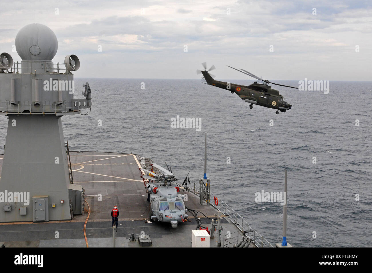BLACK SEA (Oct. 23, 2014) - A Romanian navy IAR -330 medium utility helicopter conducts flight operations aboard - Stock Image