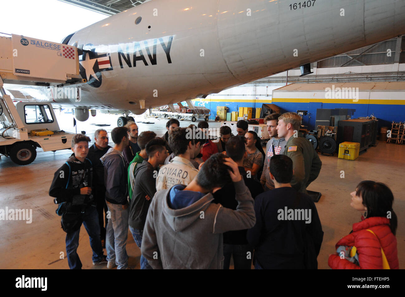SIGONELLA, Sicily (Oct. 27, 2014) Naval Aircrewmen 2nd Class Andrew Brislane answers questions about Patrol Squadron - Stock Image