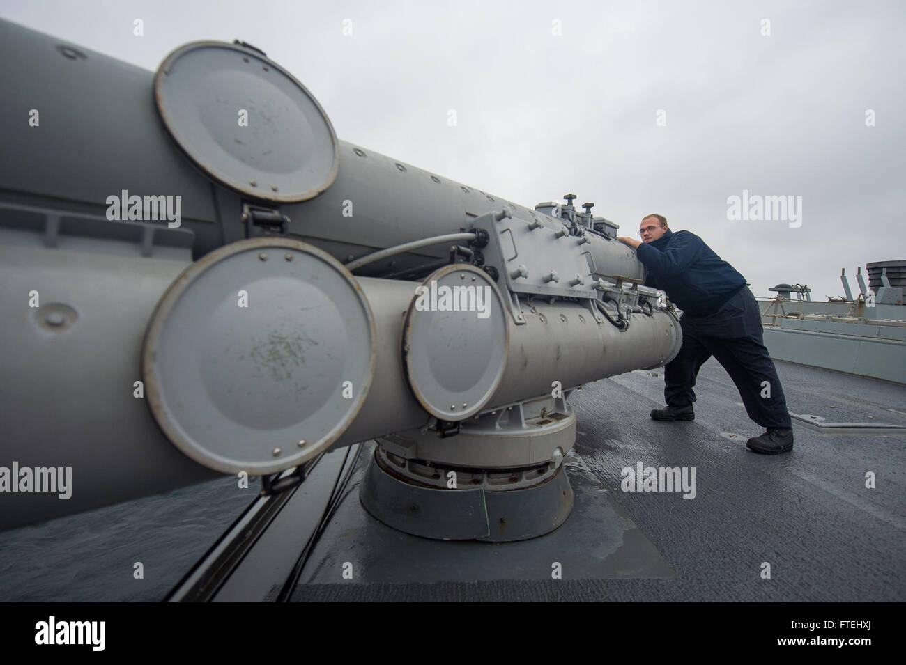 BLACK SEA (Oct. 29, 2014) – Gunner's Mate Seaman James Lumbley rotates a Mark 32 torpedo tube outboard aboard the Stock Photo