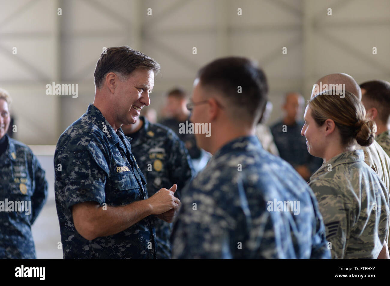 SIGONELLA, Sicily (Oct. 29, 2014) Adm. Mark Ferguson, commander of U.S. Naval Forces Europe-Africa, speaks to an - Stock Image
