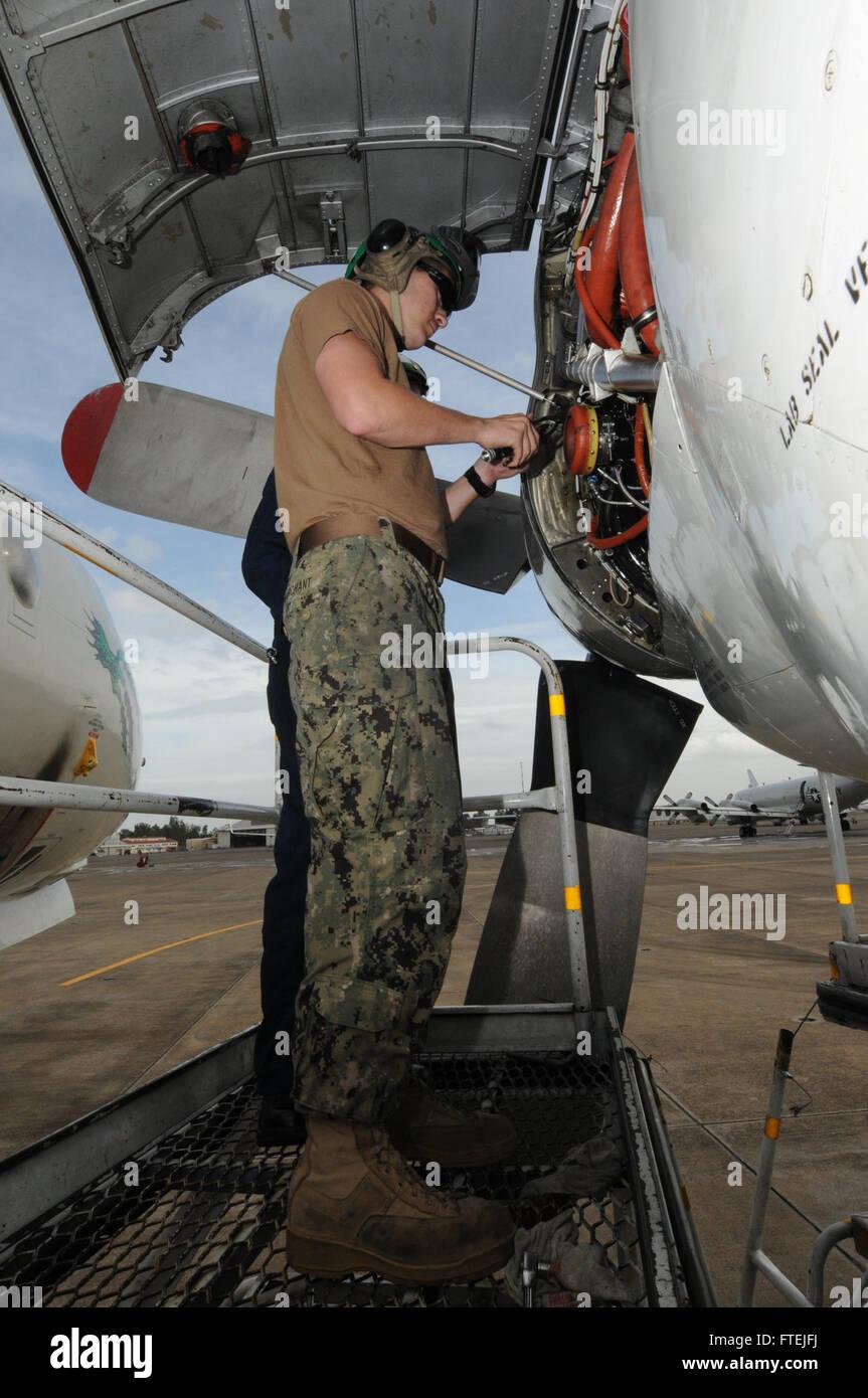 SIGONELLA, Sicily (Dec. 3, 2014) Aviation Machinist's Mate Airman Brandon Marchant installs safety wires onto a - Stock Image