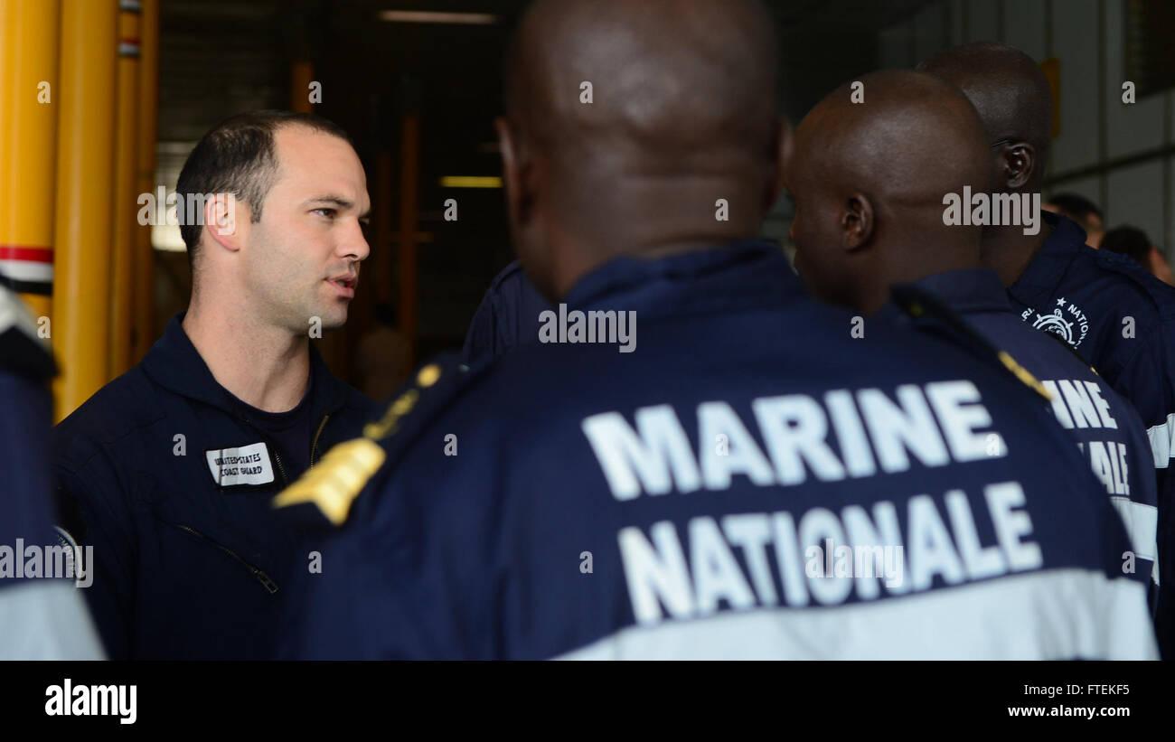 ATLANTIC OCEAN (Jan. 24, 2015) Lt. Matthew Leisy, assigned to U.S. Coast Guard Law Enforcement Detachment 407, discusses Stock Photo
