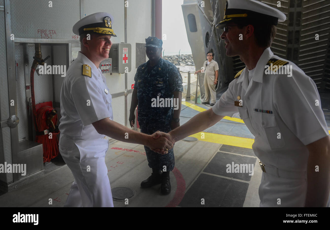 SEKONDI, Ghana (Feb. 24, 2015) U.S. 6th Fleet Vice Commander, Rear Adm. Tom Reck, left, shakes hands with the Military Stock Photo