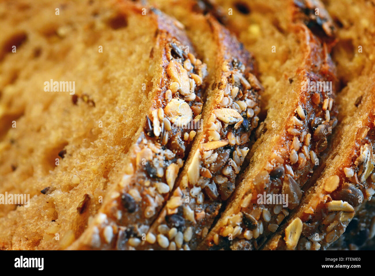 Grained bread slices, Close up - Stock Image