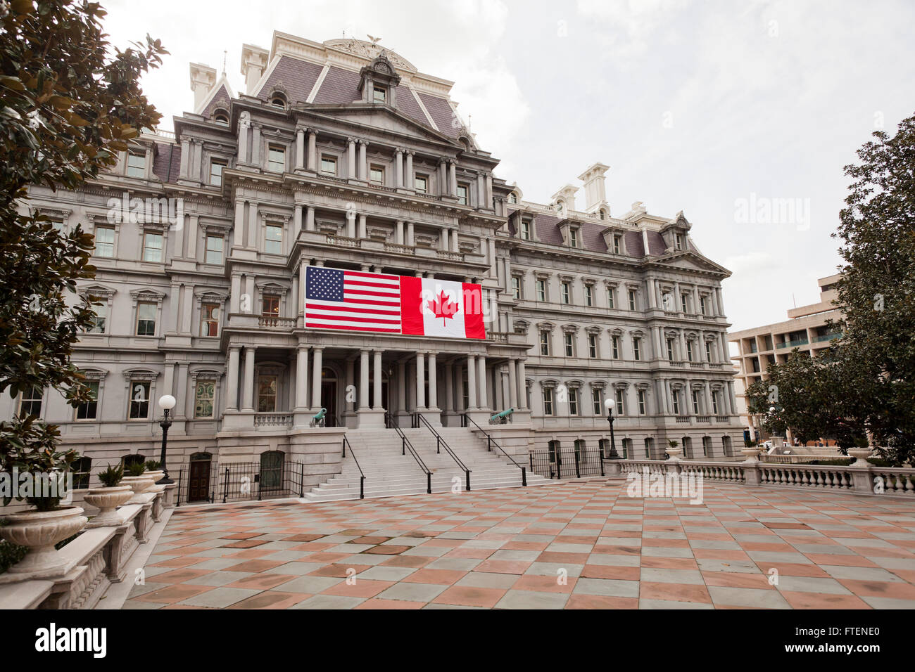 US / Canada flags hung on The Eisenhower Old Executive Offices building - Washington, DC USA - Stock Image