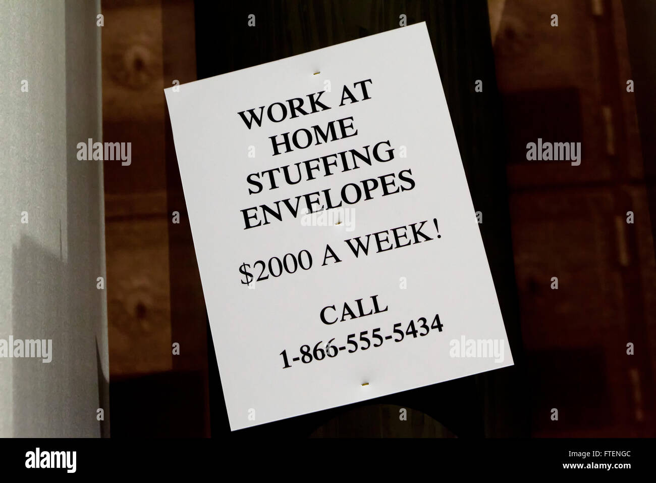 Work-From-Home scheme ad (get-rich-quick scam) - USA  **FICTIONAL AD** - Stock Image