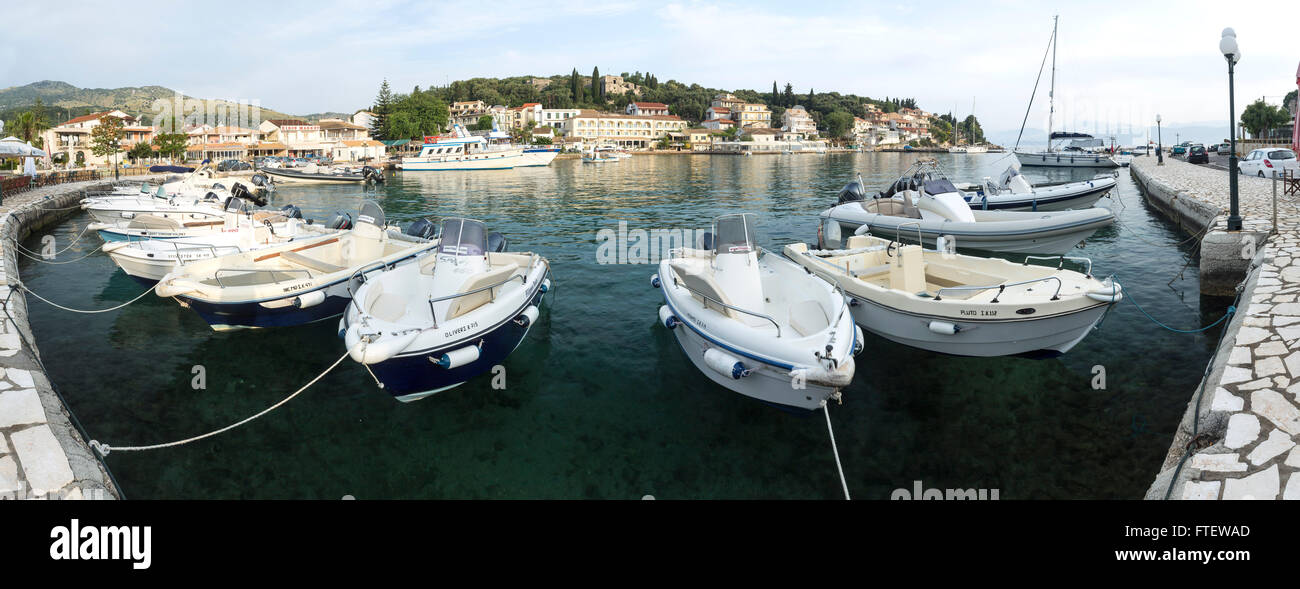 Power boats are moored up at the harbour at Kassiopi in the morning light. Stock Photo