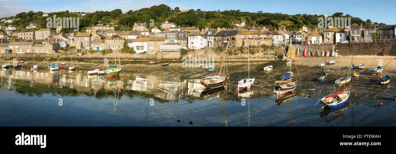 Paramic photograph of Mousehole harbour with fishing boats, Cornwall, England Stock Photo
