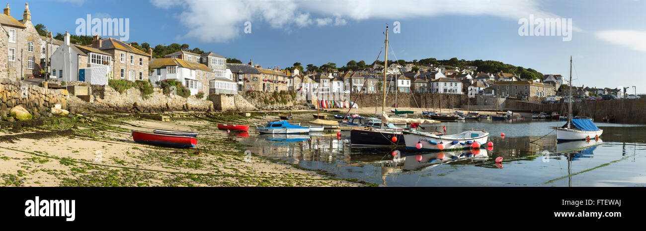 Fishing boats moored up in Mousehole harbour, Cornwall, England Stock Photo