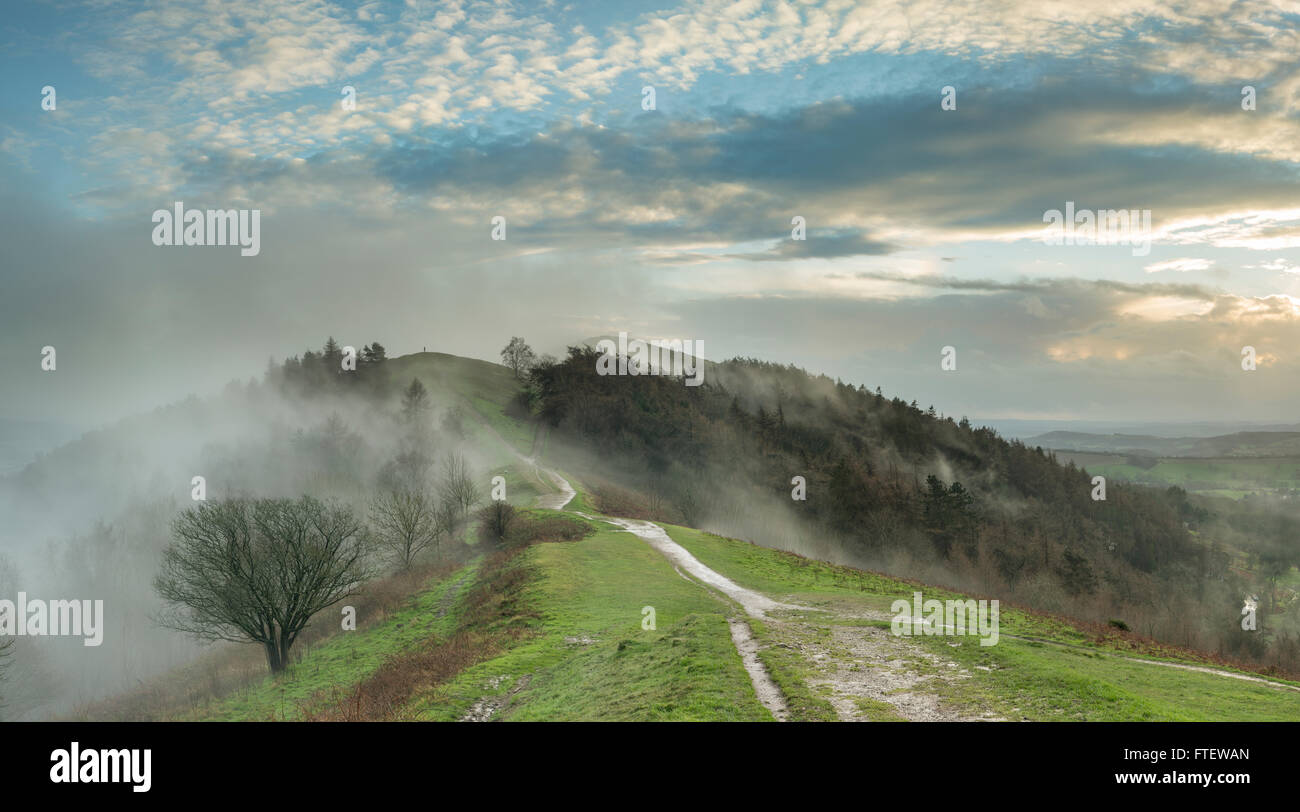 Mist and clouds rise over Jubillee Hill and Perseverance Hill after a heavy Winter rain storm over the Malvern Hills, Stock Photo