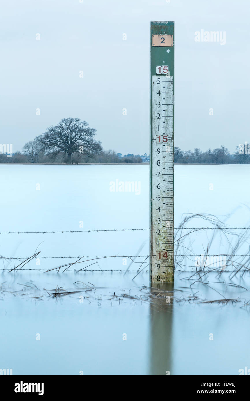 A Flood Gauge marker stand in a flooded stretch of the River Severn at Worcester, Worcestershire Stock Photo