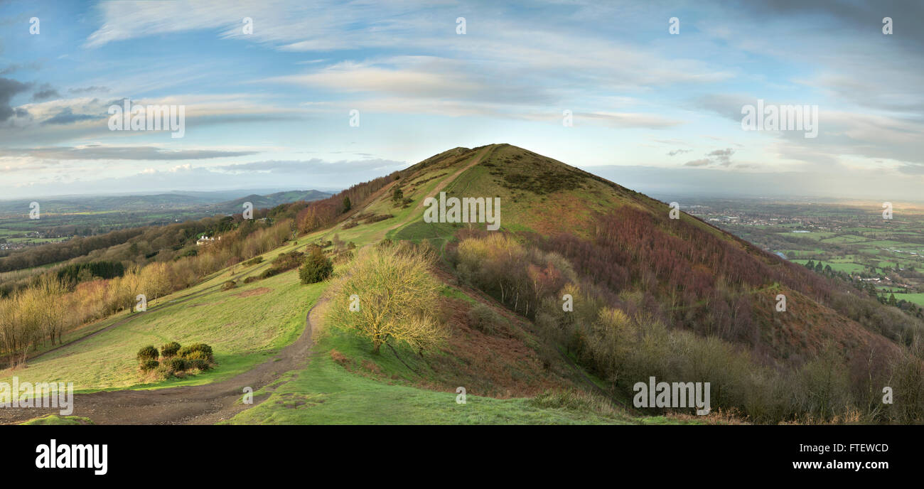 Black Hill, part of the Malvern Hills, catches the last of the sunlight as the sun sets over Worcestershire. Stock Photo
