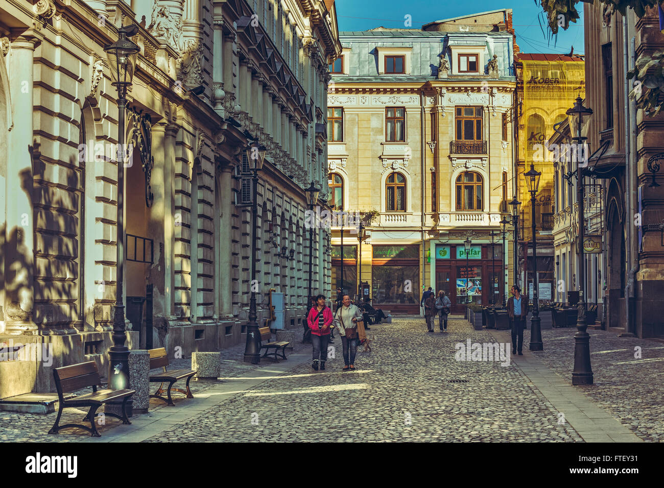 Bucharest, Romania - October 6, 2013: Tourists wander the cobblestone streets of the historic center Lipscani, the - Stock Image