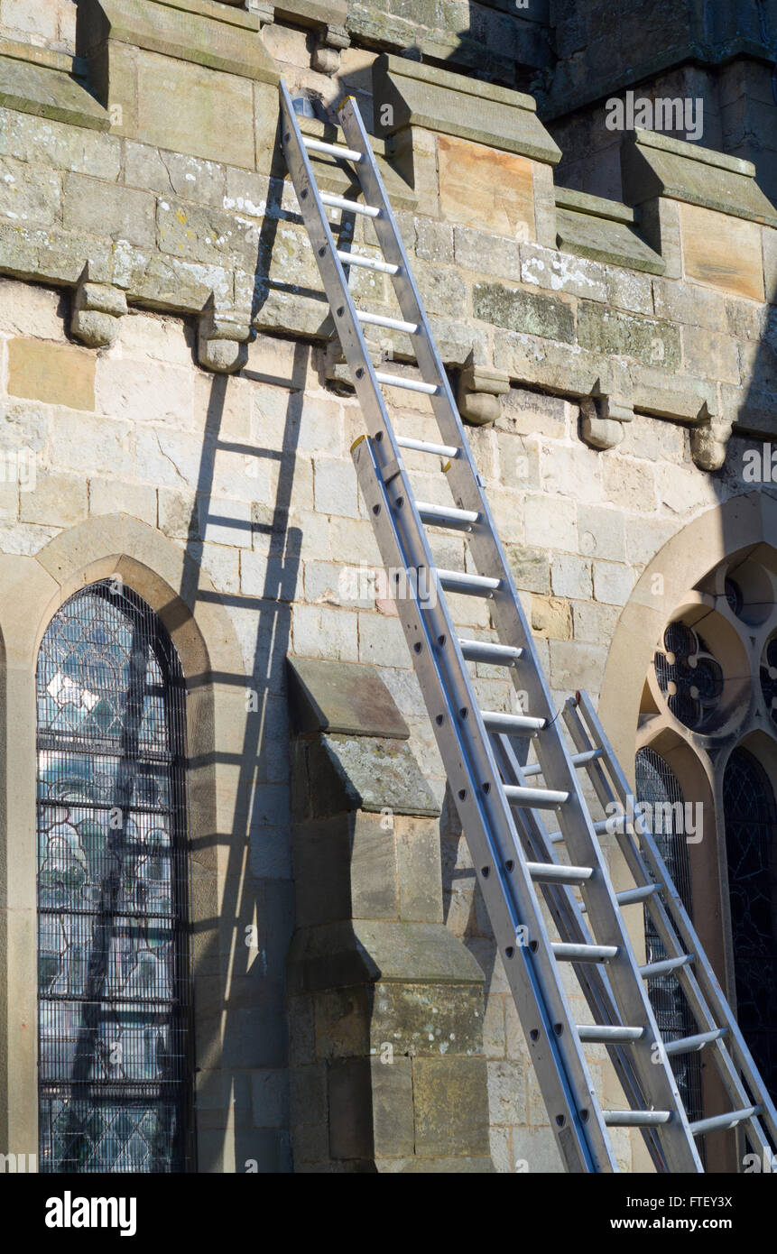 Ladder lent up against a church St Oswalds Church Filey North Yorkshire UK - Stock Image