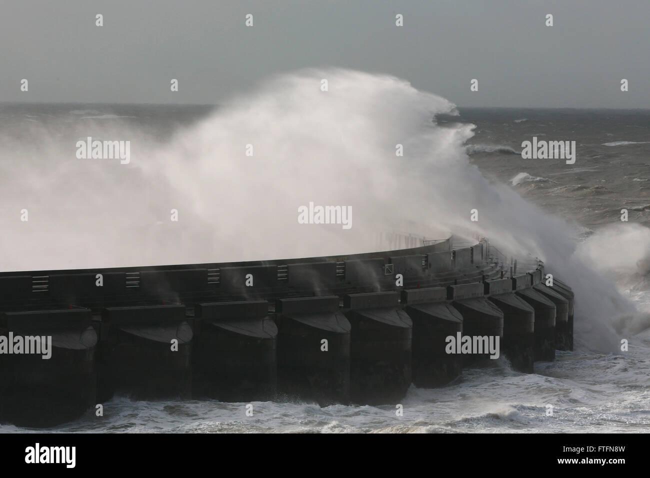Brighton, UK. 28th Mar, 2016. Waves crash over the Brighton Marina wall as Storm Katie batters the coast at Brighton, Stock Photo