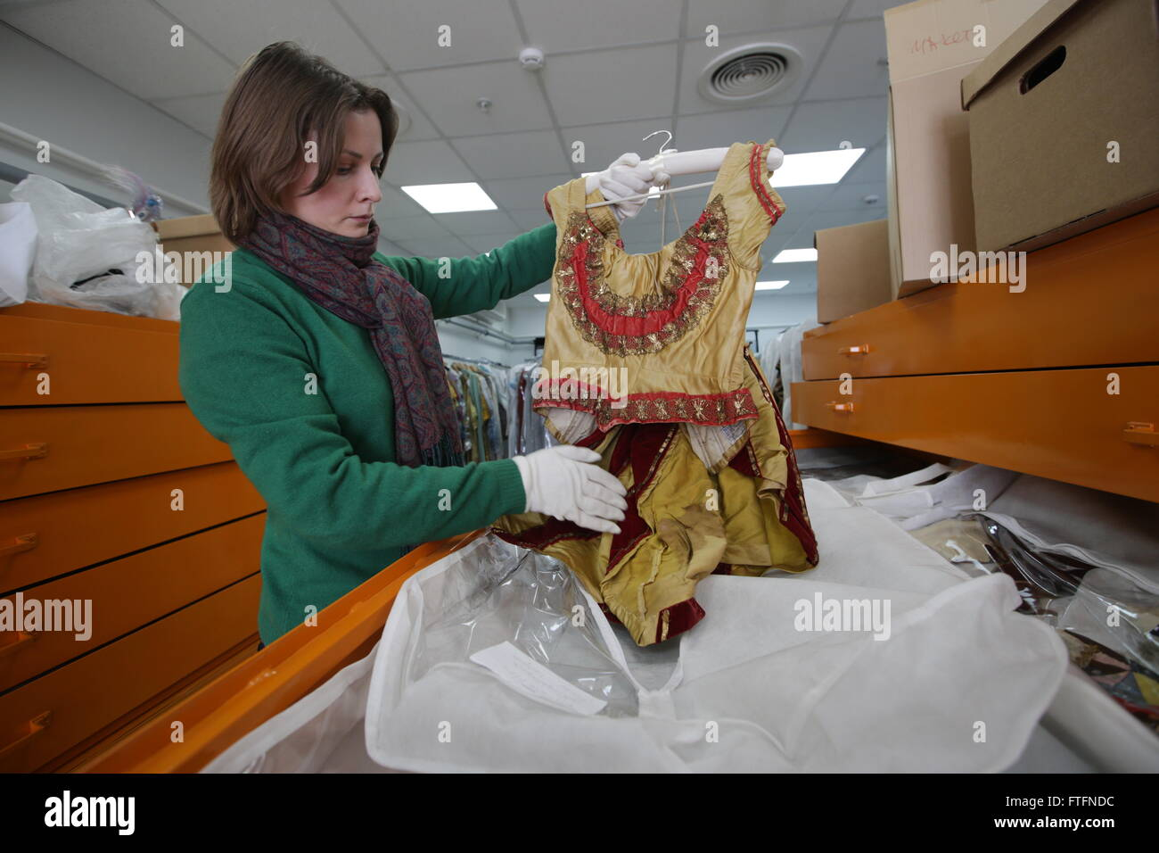 MOSCOW, RUSSIA. MARCH 23, 2016. Bolshoi researcher Anastasia Belevich shows a dress worn by ballet dancer Anna Sobeshchanskaya Stock Photo