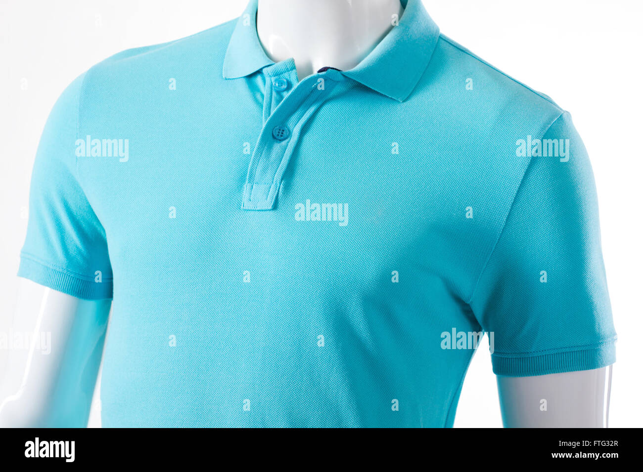 20467ab17bd2 Light blue t-shirt on mannequin. Male mannequin in polo t-shirt. Casual  light garment for men. T-shirt sale at local store.