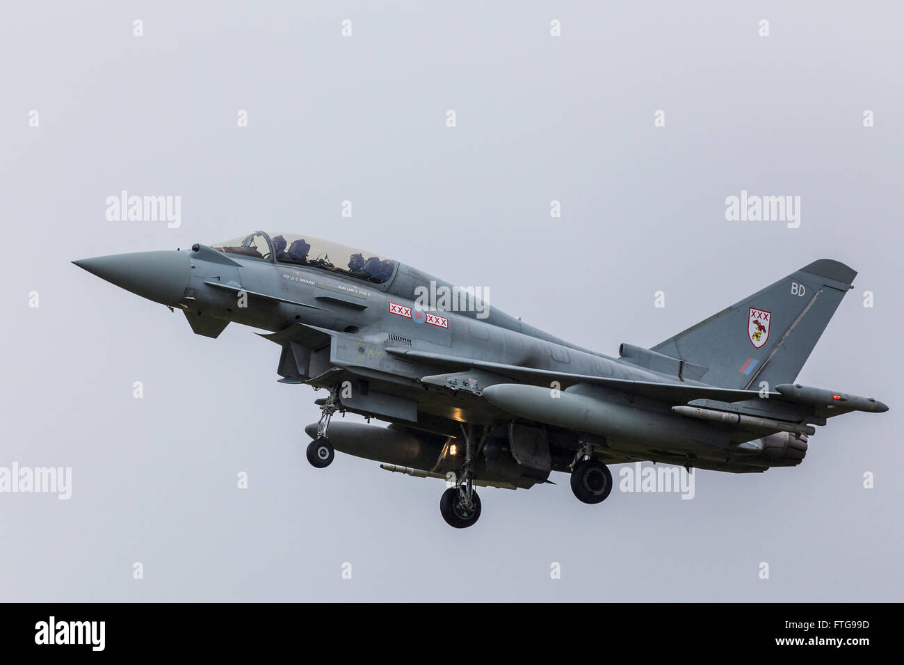 A twin-seat Typhoon flown by the RAF lands at Coningsby. Stock Photo