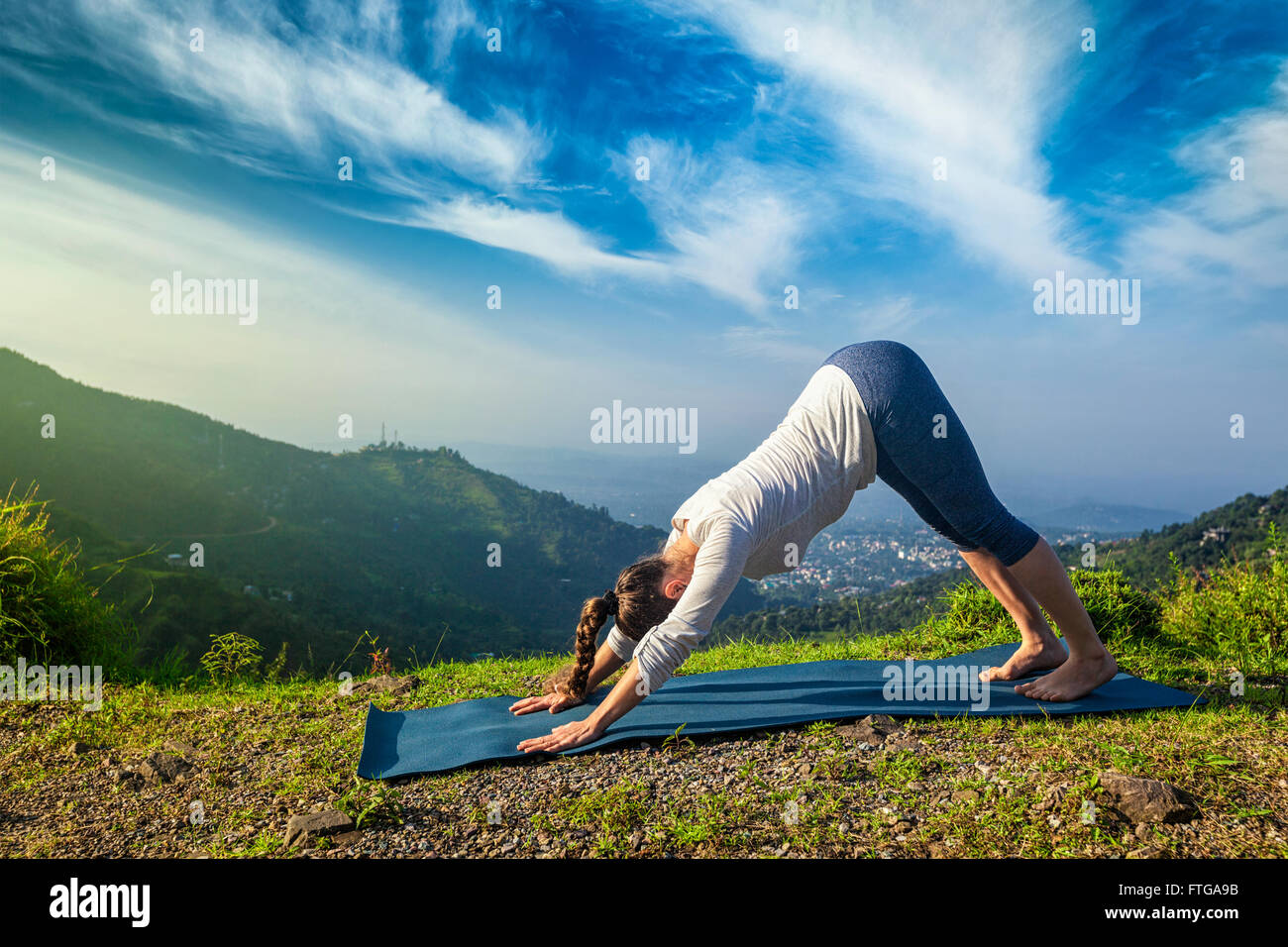 Woman doing yoga oudoors in mountains - Stock Image