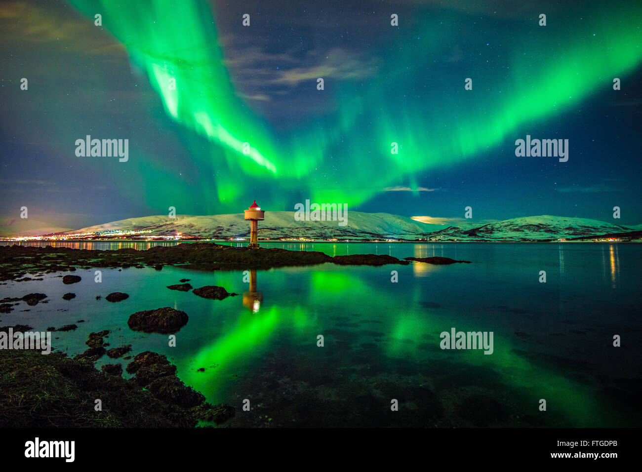 Aurora Borealis dancing over fjord, Tromso Northern Norway Stock Photo