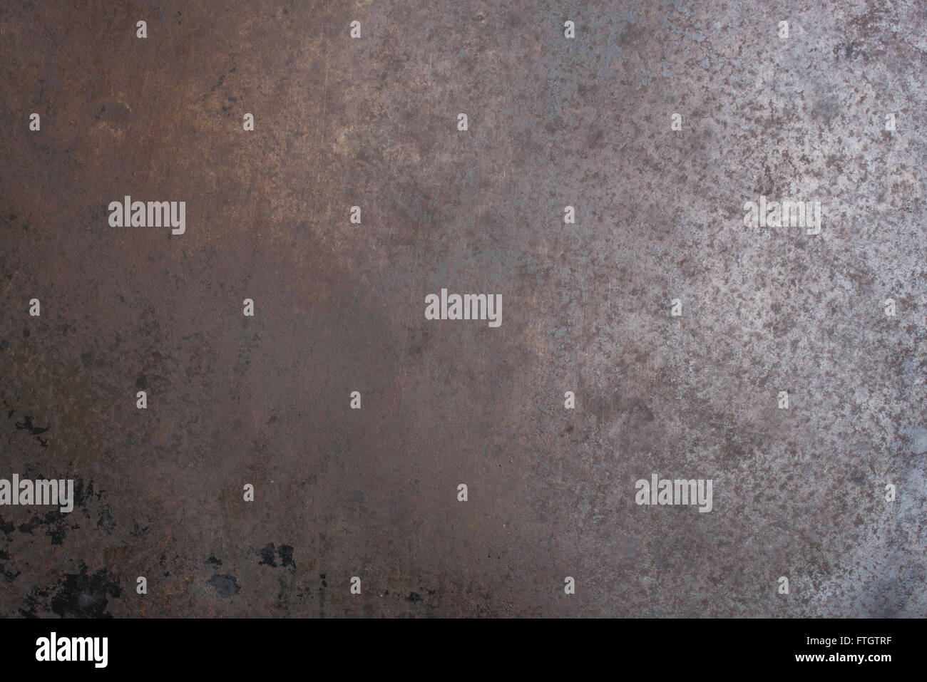 Old baking plate with rust as background - Stock Image