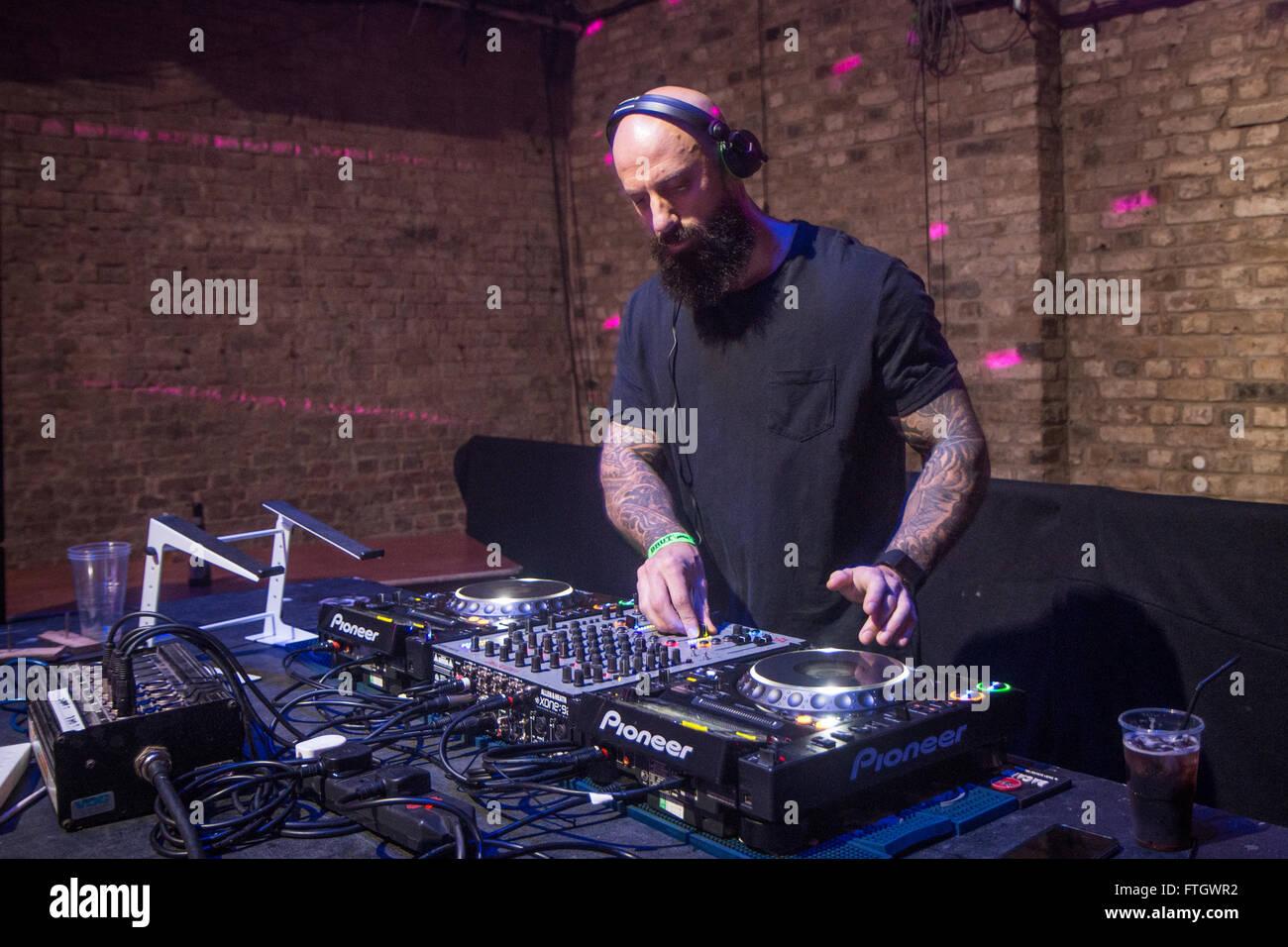 DJ Richard Harrington at the deck - Stock Image