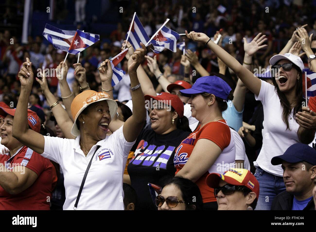 Fans react during an exhibition baseball game between the Tampa Bay Rays and the Cuban National Team at the Estadio - Stock Image