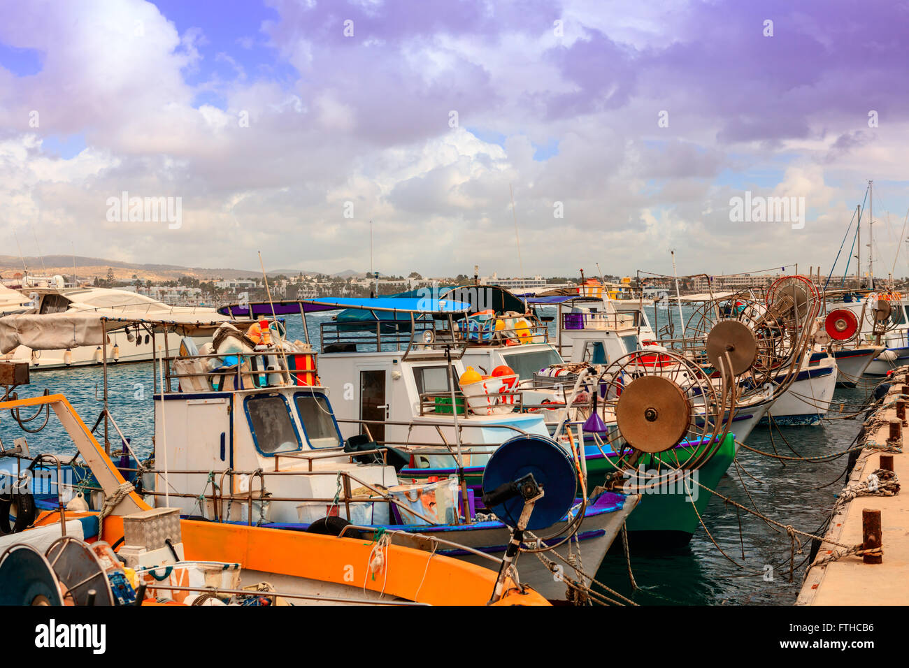 Row of fishing boats in Paphos harbor. - Stock Image