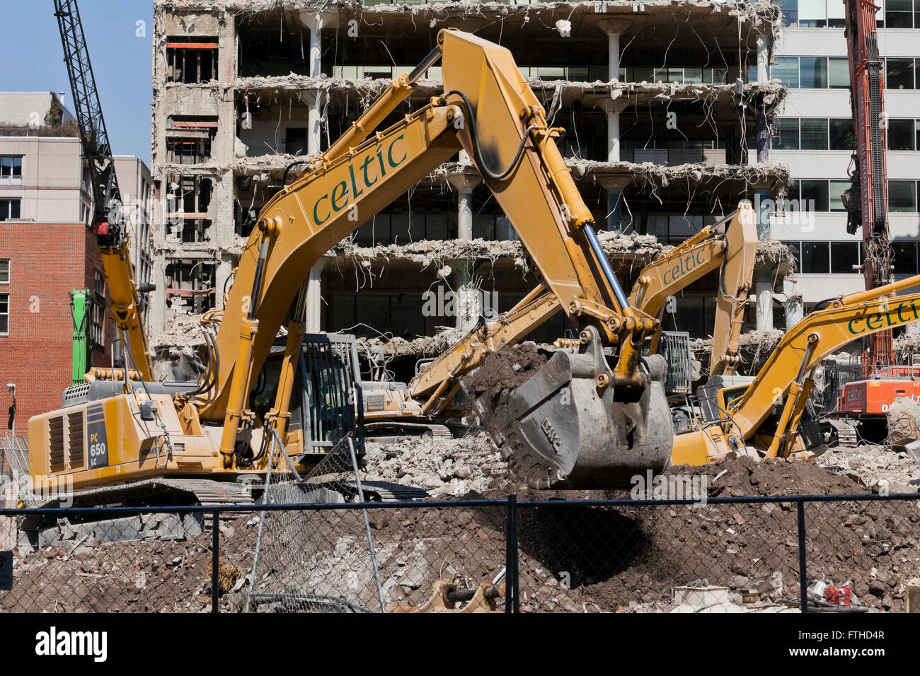 Caterpillar excavator at building demolition site - Washington, DC USA - Stock Image