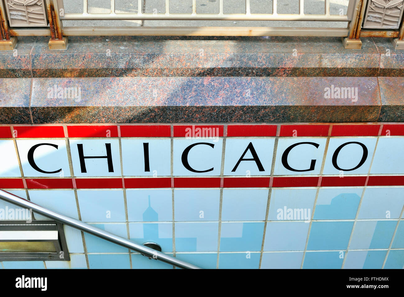 The station name in tile on an entryway to the CTA subway station at ...