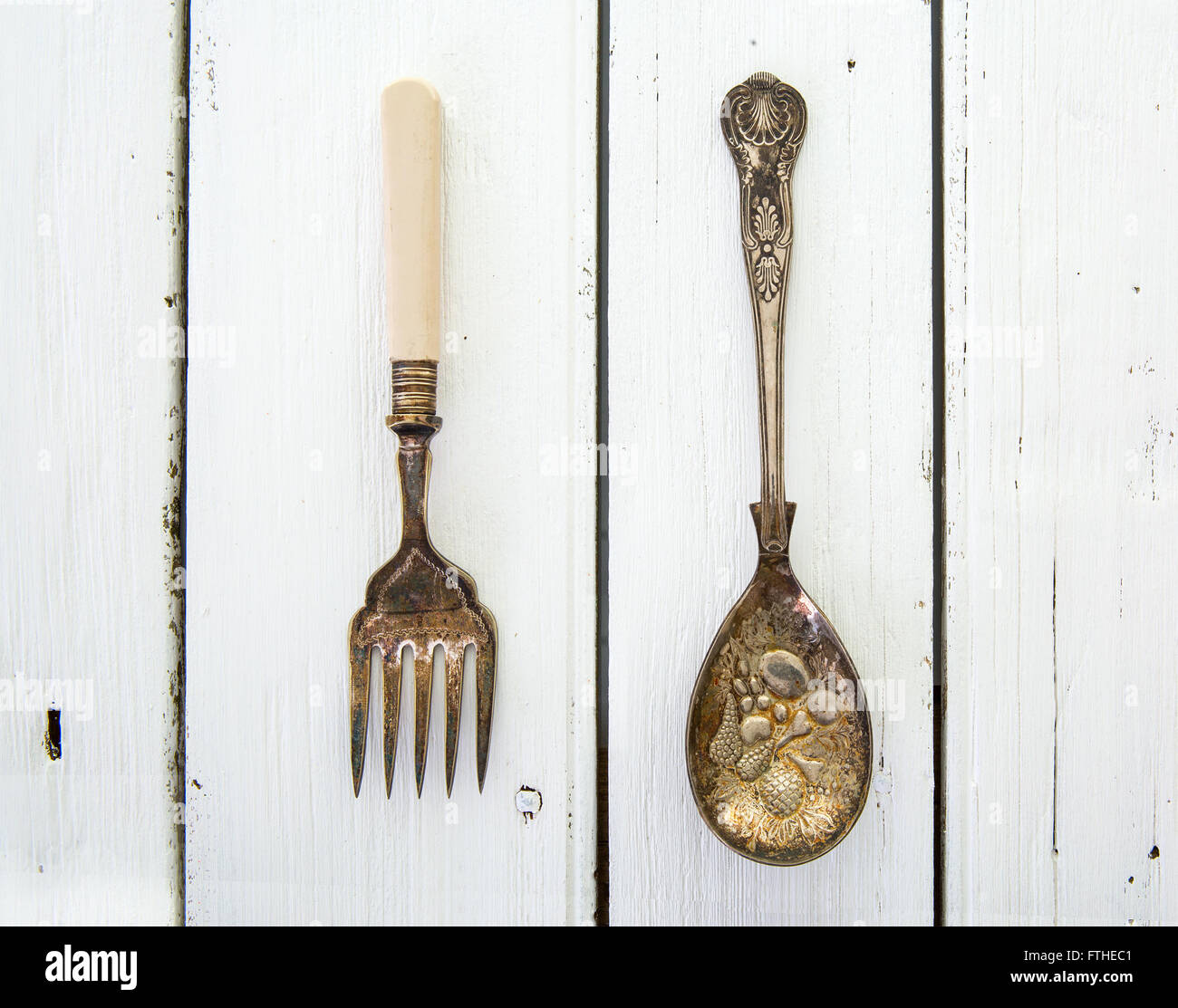 Vintage Fork and Spoon on a rustic white wooden table - Stock Image