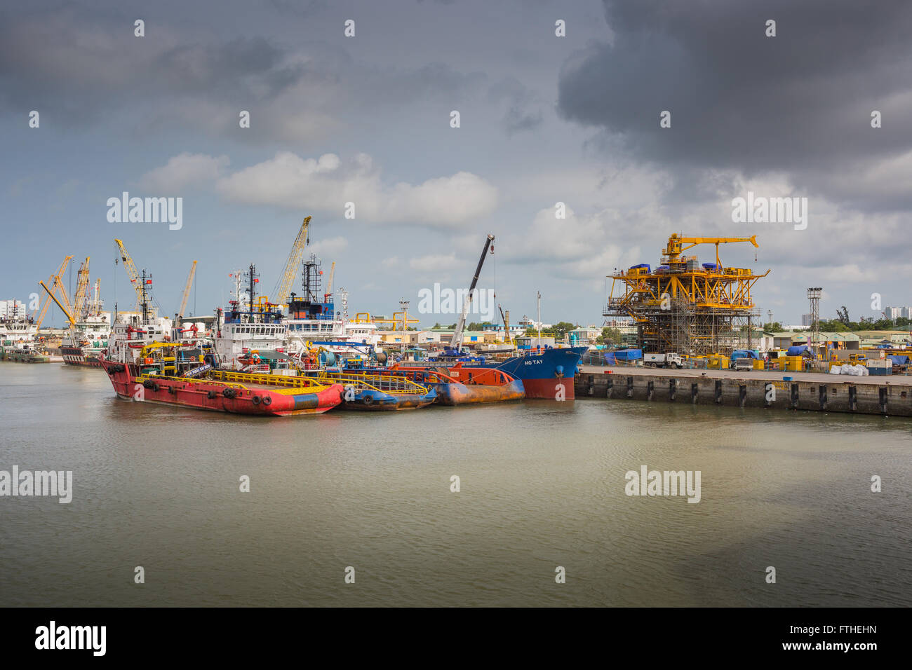 oil rig construction yard with assistance vessels stock photo