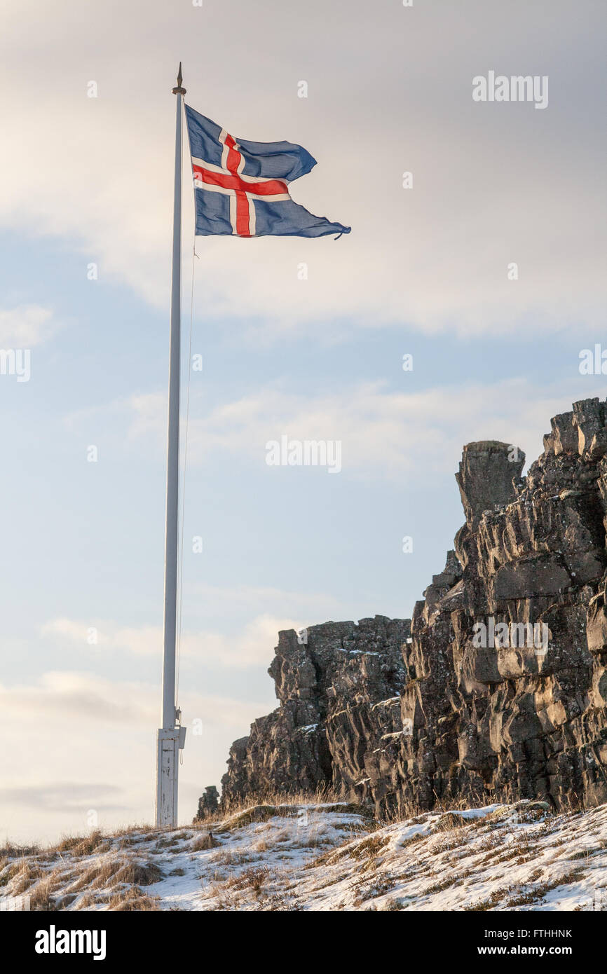 Icelandic flag flying from a flagpole at Thingvellir National Park in winter - Stock Image