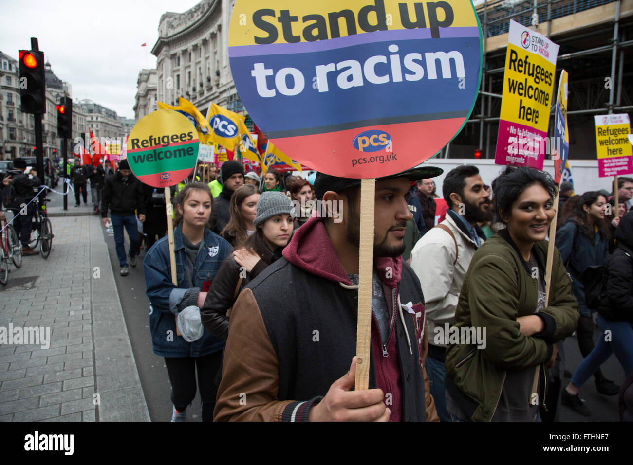 Demonstrators at Anti-racism Day demonstration led by Stand Up To Racism on 19th March 2016 in London, United Kingdom. - Stock Image