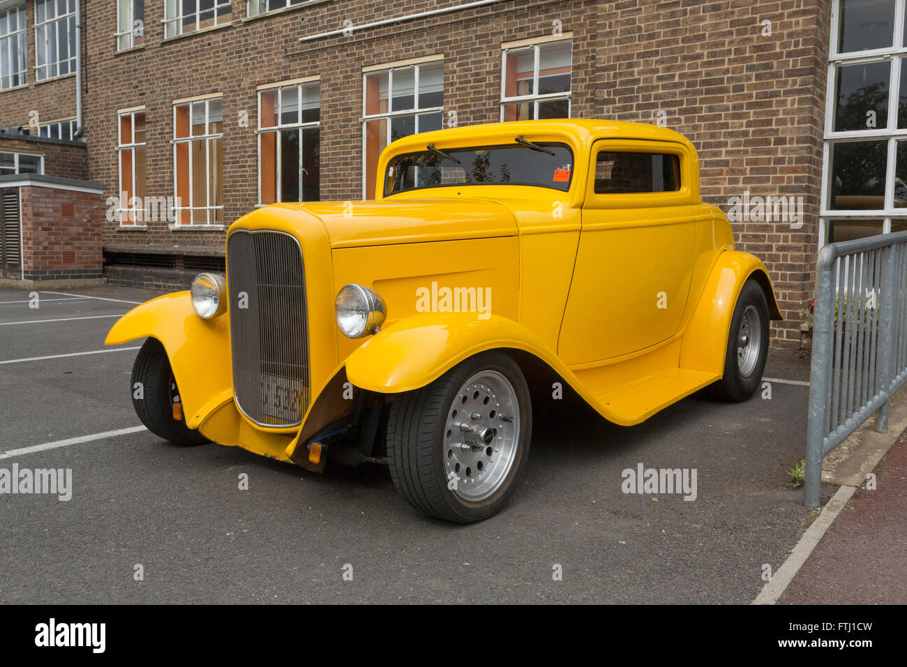 yellow custom car in the UK - Stock Image