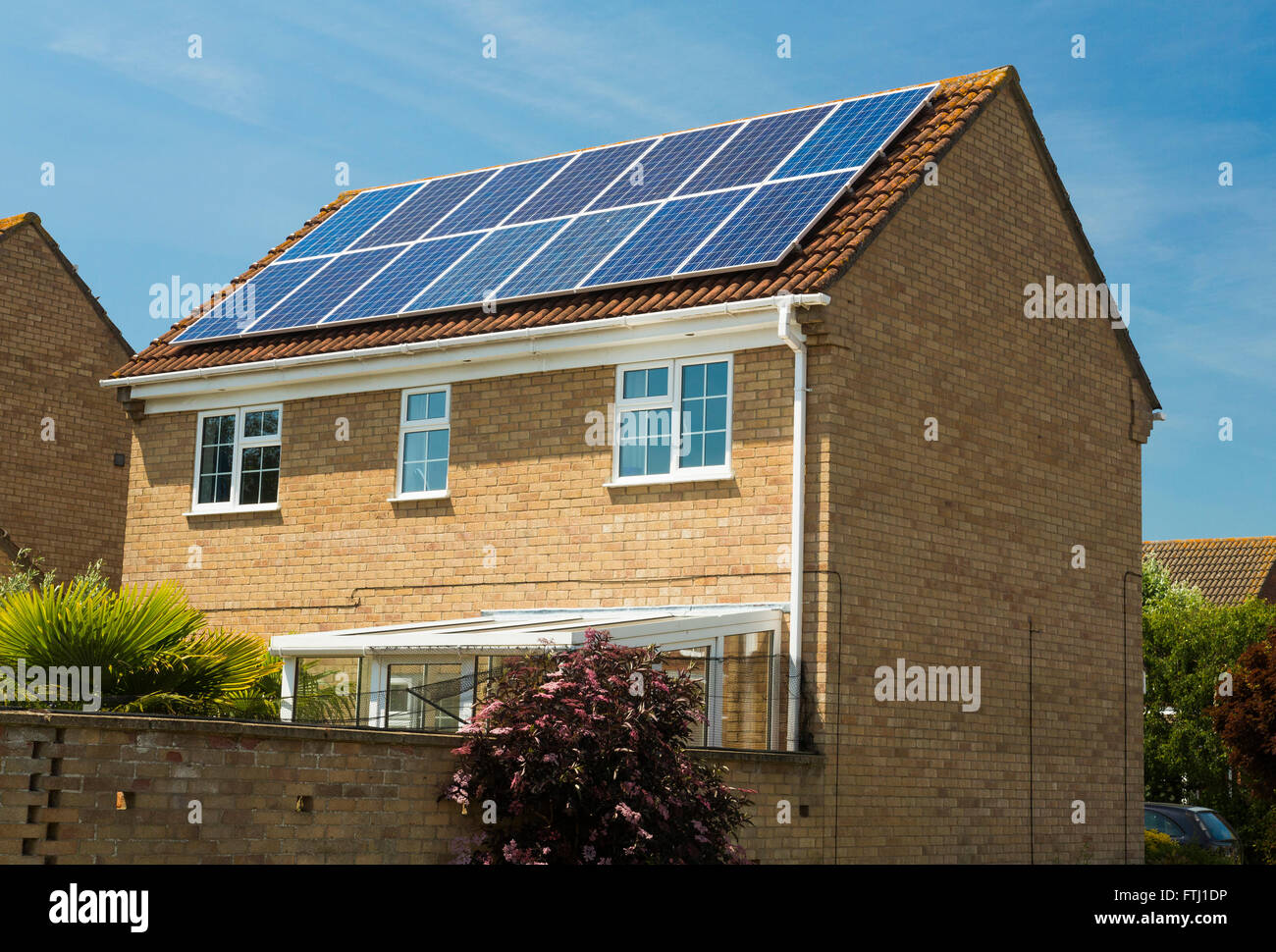 photovoltaic solar panels on house in the UK - Stock Image