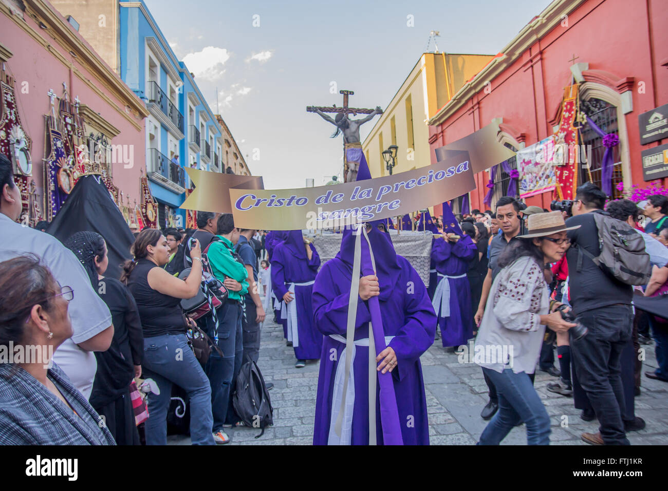 People at the Holy Friday procession in Oaxaca, Mexico. The placard says 'Christ of the precious blood.' - Stock Image