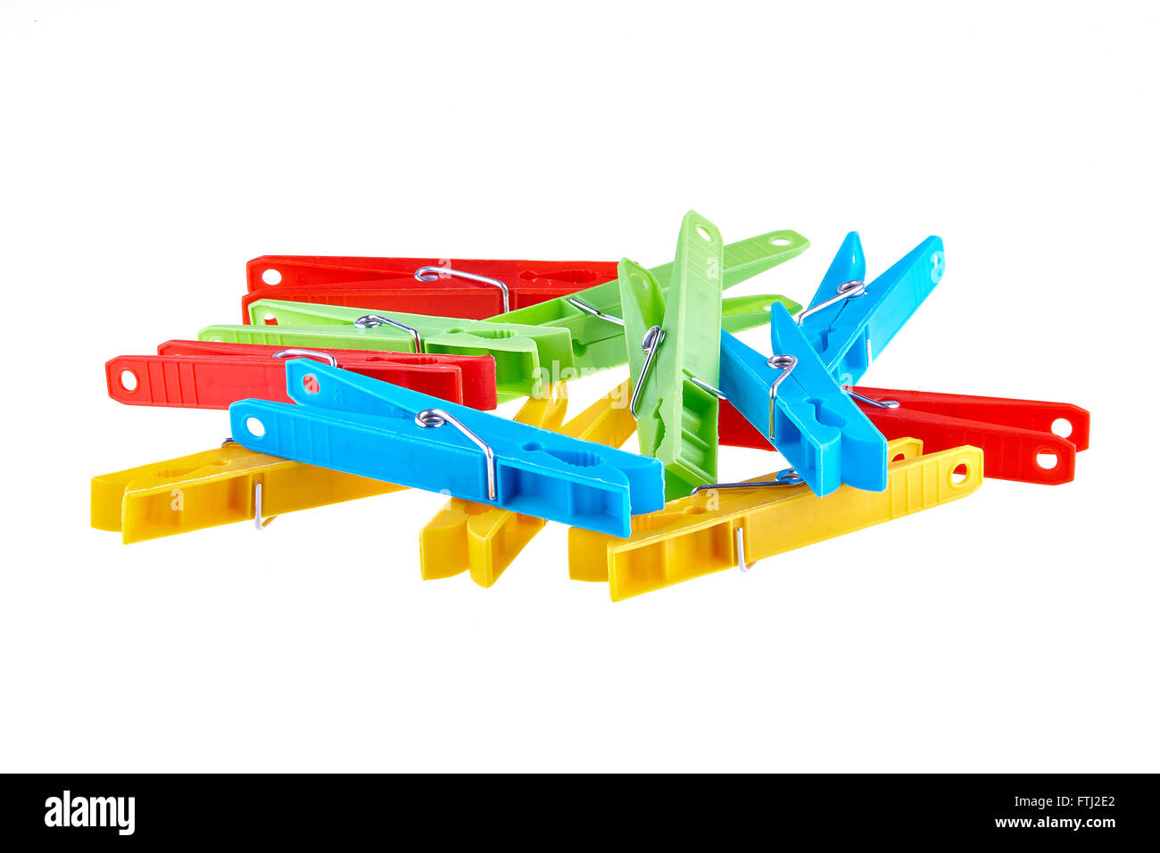 Set color clothes-pegs over white Stock Photo