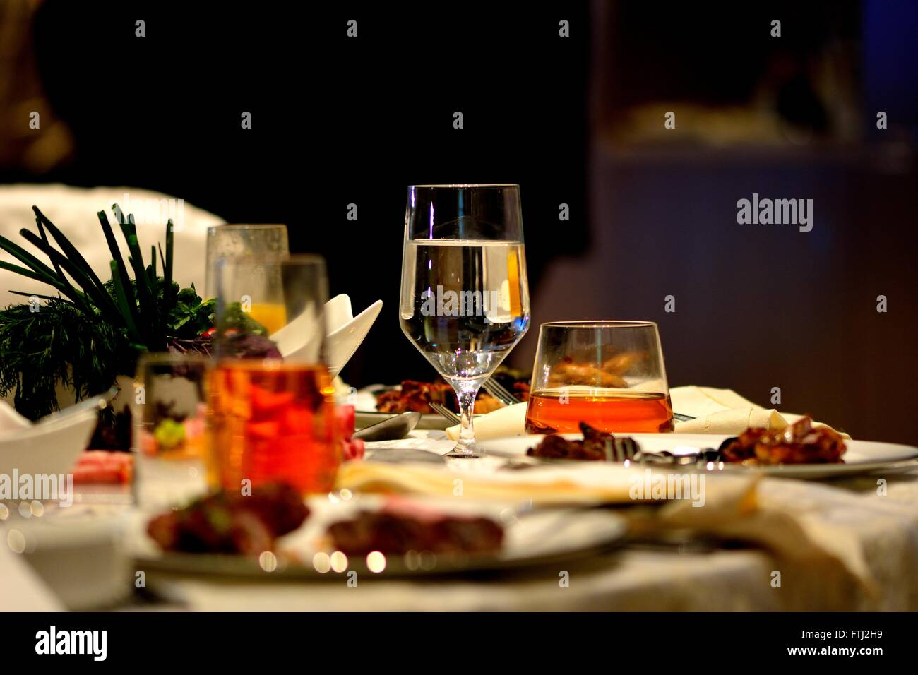 Azerbaijani wedding feast. Food and drink on a wedding table in Azerbaijan, including water, whiskey and food - Stock Image